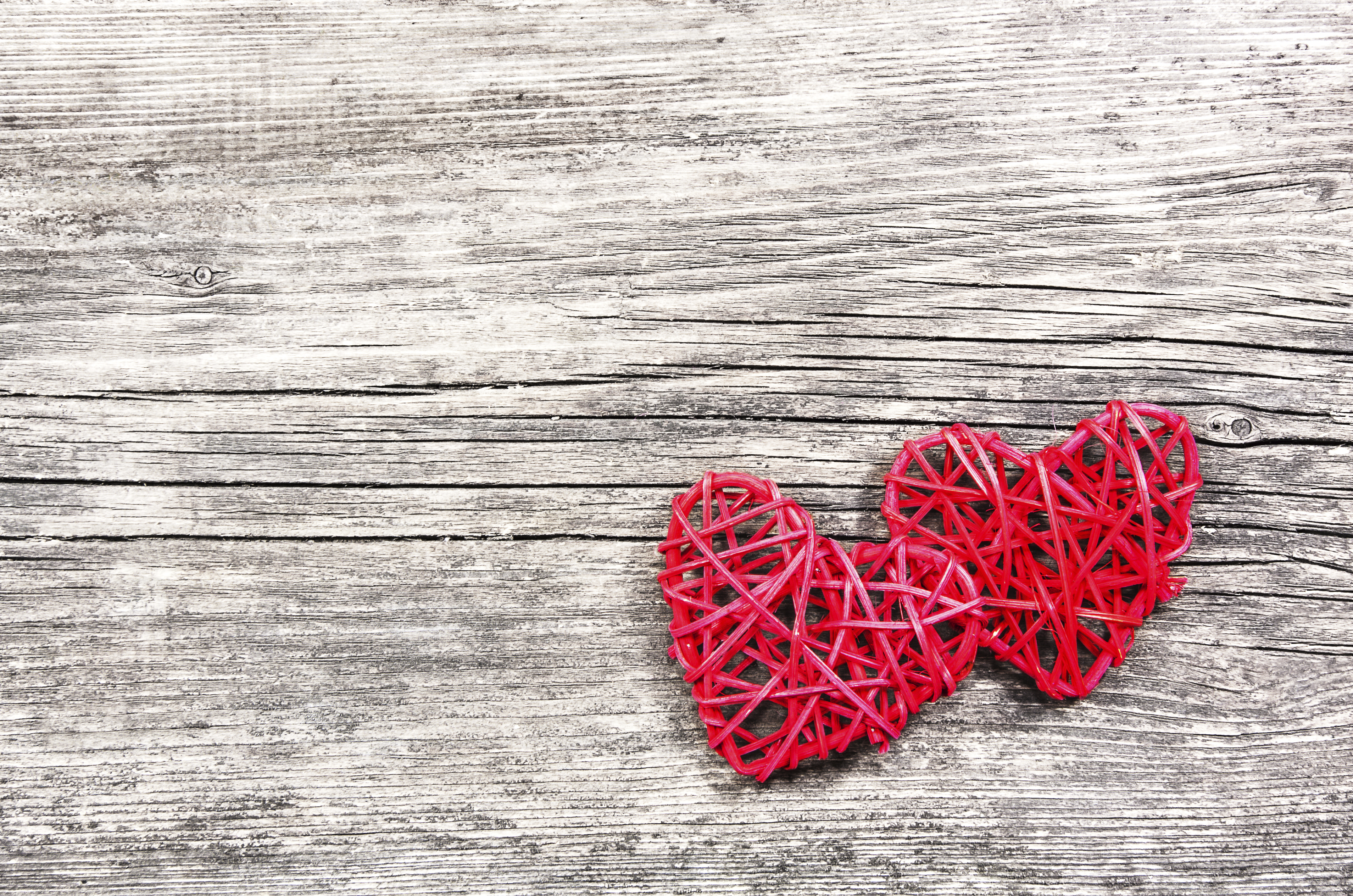 Two red hearts on vintage wooden background